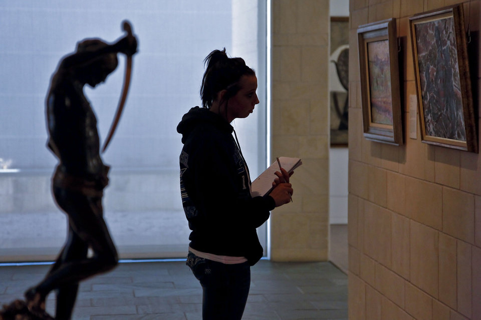 Photo - Student Rebecca Engle studies a piece of art at the Fred Jones Jr. Museum of Art on the University of Oklahoma campus in Norman. Photos by Chris Landsberger, The Oklahoman Archives