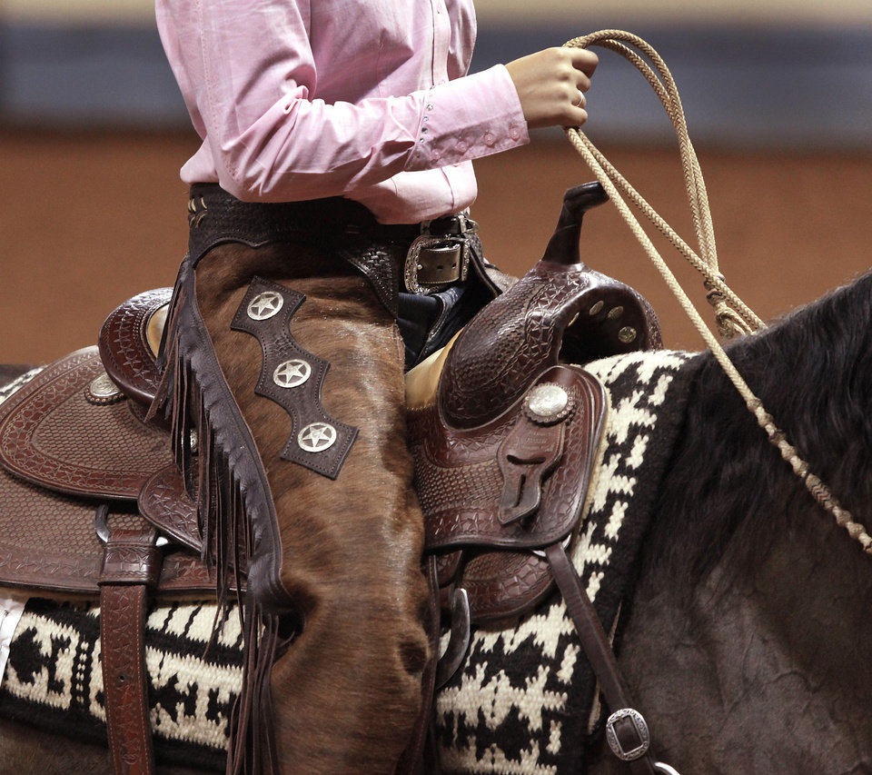 Kathryn McFarlin of Franklin, Tenn., rides Pica Peppy on Saturday at the American Quarter Horse Youth Association's world championship at State Fair Park. PHOTO BY JIM BECKEL, THE OKLAHOMAN <strong>Jim Beckel</strong>