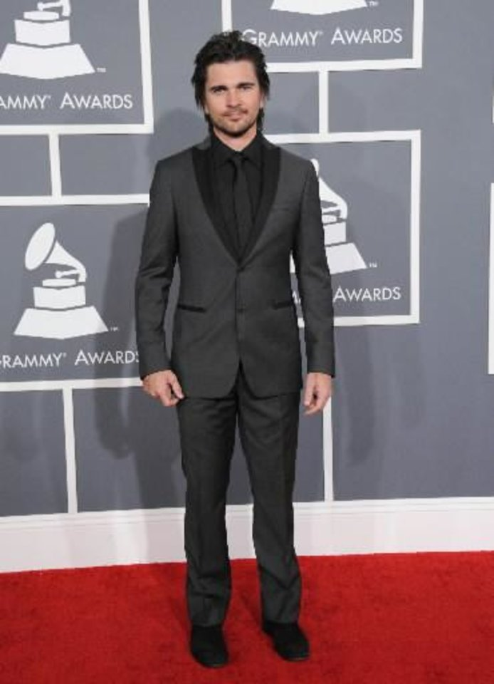 Colombian singer Juanes arrives at the 55th annual Grammy Awards on Sunday, Feb. 10, 2013, in Los Angeles. (AP)