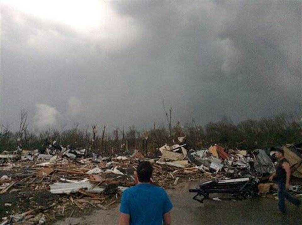 Photo -  This photo provided by James Bryant shows tornado damage, Sunday, April 27, 2014 in Mayflower, Ark. A powerful storm system rumbled through the central and southern United States on Sunday, spawning several tornadoes, including one  in a small northeastern Oklahoma city and another that carved a path of destruction through several northern suburbs of Little Rock, Ark. (AP Photo/Courtesy of James Bryant) MANDATORY CREDIT