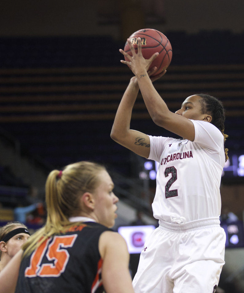 Photo - South Carolina's Olivia Gaines (2) shoots as Oregon State's Jamie Weisner defends during the first half of a second-round game in the NCAA women's college basketball tournament Tuesday, March 25, 2014, in Seattle. (AP Photo/Stephen Brashear)