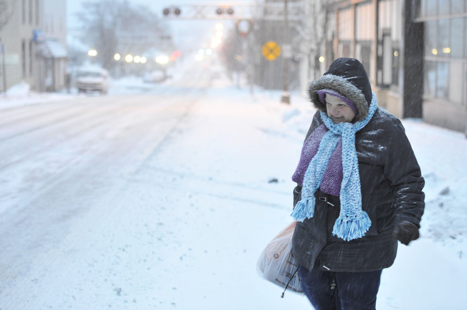 Photo - Susan Miller of Windber, Pa. walks during the snow storm on Tuesday, Jan. 21, 2014.  The National Weather Service said the storm could bring 8 to 12 inches of snow to Philadelphia and New York City, and more than a foot in Boston.  (AP Photo/The Tribune-Democrat, Todd Berkey) THE MORNING CALL OUT; DAILY AMERICAN OUT; WJAC-TV OUT