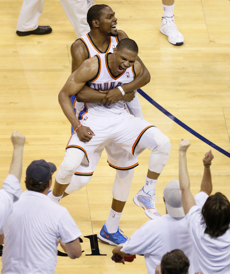 Oklahoma City\'s Russell Westbrook (0) and Kevin Durant (35) celebrate after winning Game 5 of the Western Conference semifinals in the NBA playoffs between the Oklahoma City Thunder and the Los Angeles Clippers at Chesapeake Energy Arena in Oklahoma City, Tuesday, May 13, 2014. Photo by Bryan Terry, The Oklahoman
