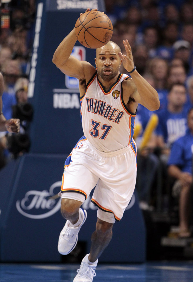 FILE - This June 12, 2012 file photo shows Oklahoma City Thunder point guard Derek Fisher (37) breaking down court against the Miami Heat during the first half at Game 1 of the NBA finals basketball series, in Oklahoma City. What a year it's been for Fisher: serving as president of players' union during the lockout, traded from the Lakers and now making another NBA Finals run with the Thunder. AP PHOTO