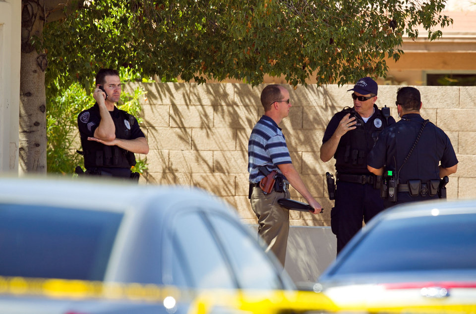 Photo -   Police officers stand outside a house after a shooting, where police say a man shot and killed four people, including a toddler, before killing himself, in Gilbert, Ariz., on Wednesday, May 2, 2012. Police say the man was armed with several firearms, and officers recovered two handguns and a shotgun. (AP Photo/The Arizona Republic, Michael Schennum)