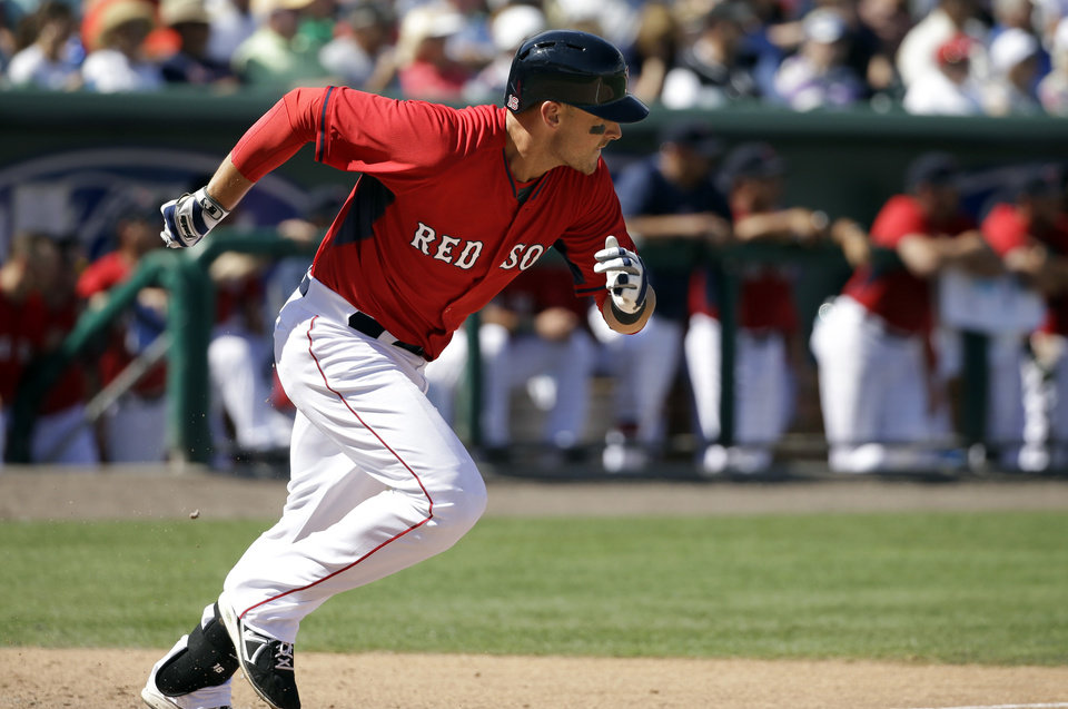 Photo - Boston Red Sox's Will Middlebrooks runs to first on a single off a pitch by Atlanta Braves pitcher Anthony Varvaro in the fifth inning of a spring exhibition baseball game on Friday, March 7, 2014, in Fort, Myers, Fla. The Red Sox won 4-1. (AP Photo/Steven Senne)