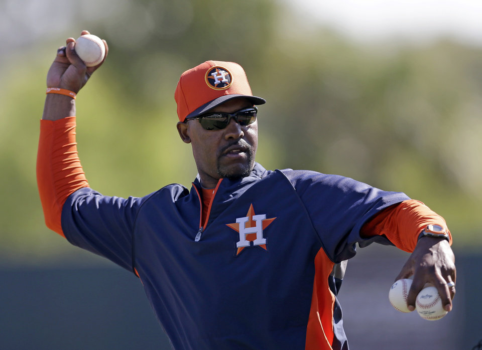 Houston Astros manager Bo Porter throws batting practice to his players before an exhibition spring training baseball game against the New York Yankees Thursday, Feb. 28, 2013, in Kissimmee, Fla. (AP Photo/David J. Phillip)