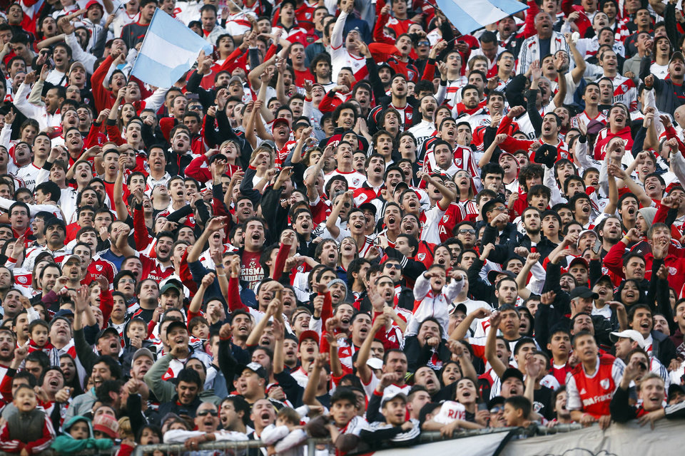 Photo - River Plate's fans cheer for their team during an Argentine league soccer match against Quilmes in Buenos Aires, Argentina, Sunday, May 18, 2014. (AP Photo/Victor R. Caivano)