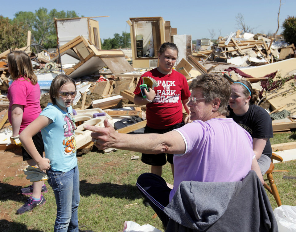 Debbie Whisennand, right, talks with, from left, Madison Diercks, 10, Alyssa Sutton, 9, Kirstyn Hines, 11, and Rachael Diercks, 13, while they take a break from going through what is left of Whisennand's home in Woodward, Okla., Monday, April 16, 2012.  Madison Diercks and Rachael Diercks used to attend the day care Whisennand ran out of her house. A tornado struck Woodward early Sunday morning. Photo by Nate Billings, The Oklahoman
