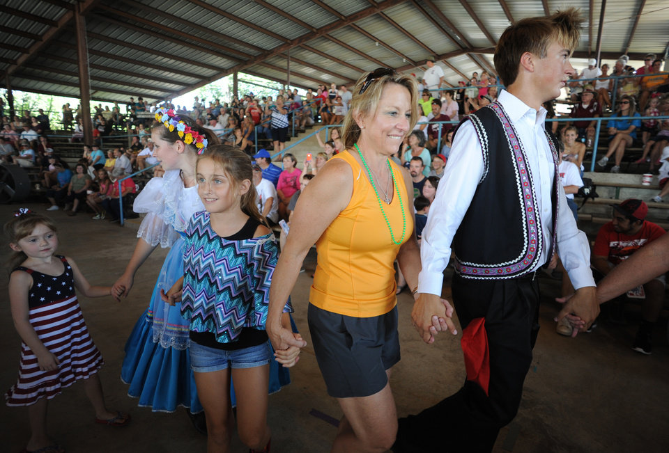 Photo - In this Saturday, Sept. 1, 2012 photo, people dance with members of the West High School Junior Historian Czech Dancers during the annual Westfest in West, Texas. Starting Friday, Aug. 30, 2013, the town will hold the signature celebration of its Czech heritage - the first Westfest since a deadly fertilizer plant explosion tore through the small Central Texas community in April 2013. (AP Photo/Waco Tribune Herald, Rod Aydelotte)