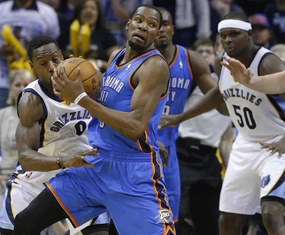 Photo - Oklahoma City's Kevin Durant (35) got past Memphis' Tony Allen (9) during Game 6  in the first round of the NBA playoffs between the Oklahoma City Thunder and the Memphis Grizzlies at FedExForum in Memphis, Tenn., Thursday, May 1, 2014. Oklahoma City won 104-84. Photo by Bryan Terry, The Oklahoman