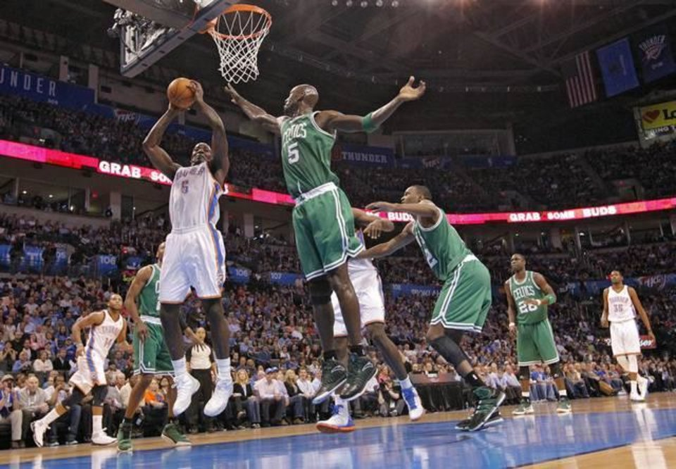 Oklahoma City Thunder center Kendrick Perkins (5) and Boston Celtics power forward Kevin Garnett (5) battle under the basket during the NBA basketball game between the Oklahoma City Thunder and the Boston Celtics at the Chesapeake Energy Arena on Wednesday, Feb. 22, 2012 in Oklahoma City, Okla.  Photo by Chris Landsberger, The Oklahoman