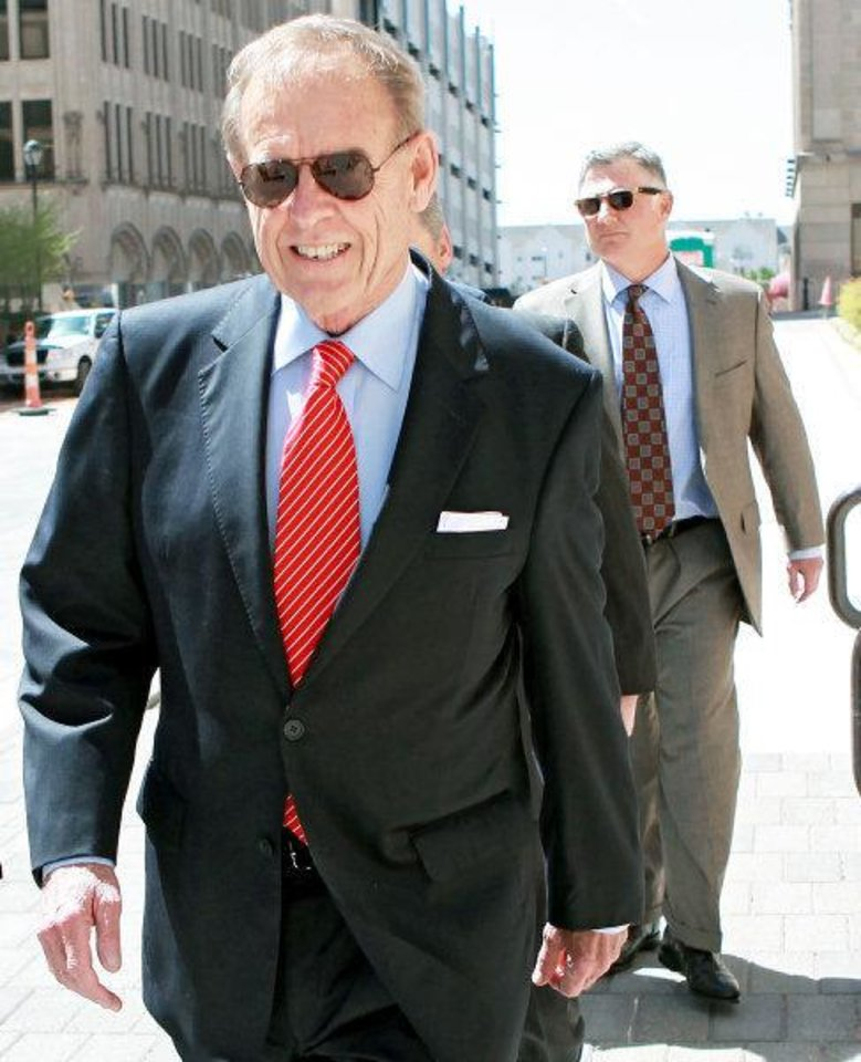 Photo - Martin Stringer (foreground) and Andrew Skeith (background) walk toward the Federal Courthouse in Oklahoma City on Wednesday, April 6, 2011. Former Senate leader Mike Morgan, lobbyist Andrew Skeith and attorney Martin Stringer pleaded not guilty at a 13-minute arraignment today in a public corruption case. Photo by John Clanton, The Oklahoman ORG XMIT: KOD