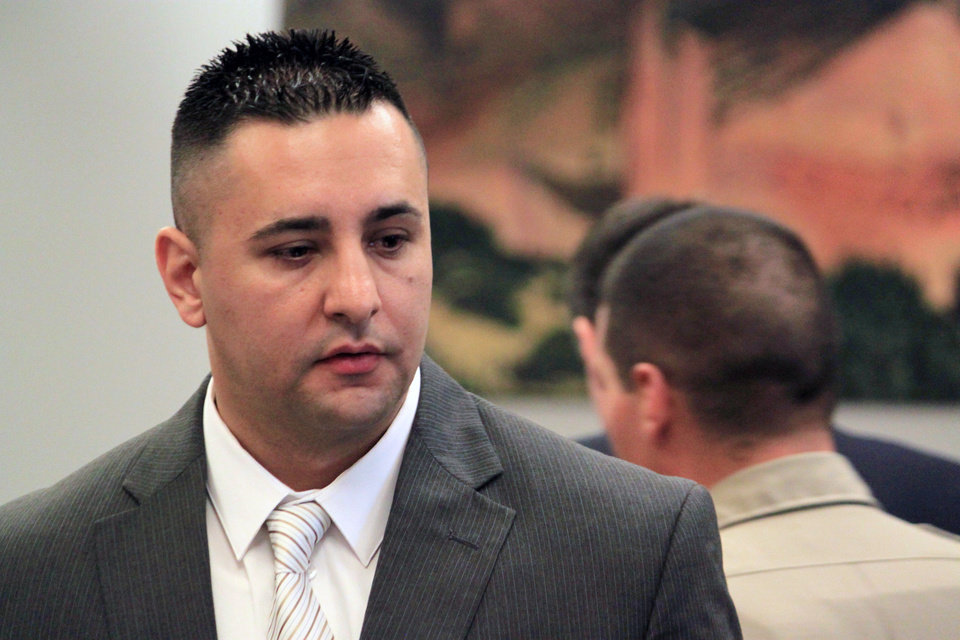 FILE - In this June 10, 2013 file photo, former Albuquerque Police Officer Levi Chavez prepares to leave the courtroom following opening statements in his trial in Bernalillo, N.M. The trial of Chavez a former Albuquerque police officer accused of killing his wife is scheduled to resume Tuesday July 9,2013 and closing arguments could come as early as this week. (AP Photo/Susan Montoya Bryan, File)