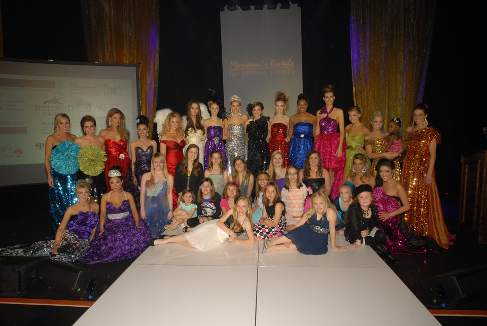 Photo -  A group of current and past Miss Oklahoma pageant winners and Miracle Children from Children's Miracle Network pose for a photo at last year's Linen Fashion Show.  Photo provided.