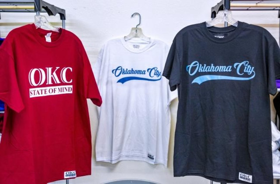 Photo -  Clothing items are shown from the OKC State of Mind clothing brand. [Chris Landsberger/The Oklahoman]