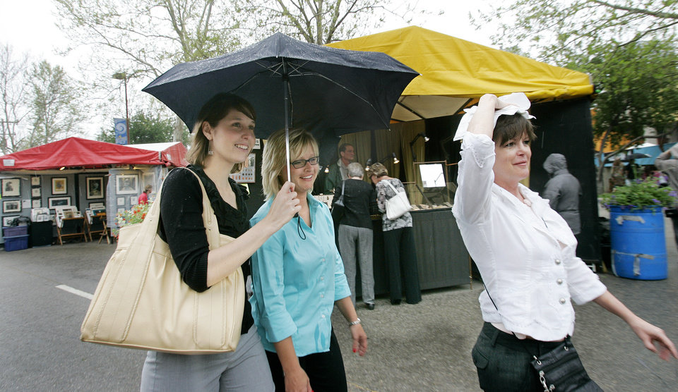 L to r - Ruth Peniston, P.J. Lea and Jeanie Herndon head for shelter after rain sprinkled around lunch time at the Festival of the Arts Wed. April 23, 2008 in downtown Oklahoma City, OK. BY JACONNA AGUIRRE/THE OKLAHOMAN.