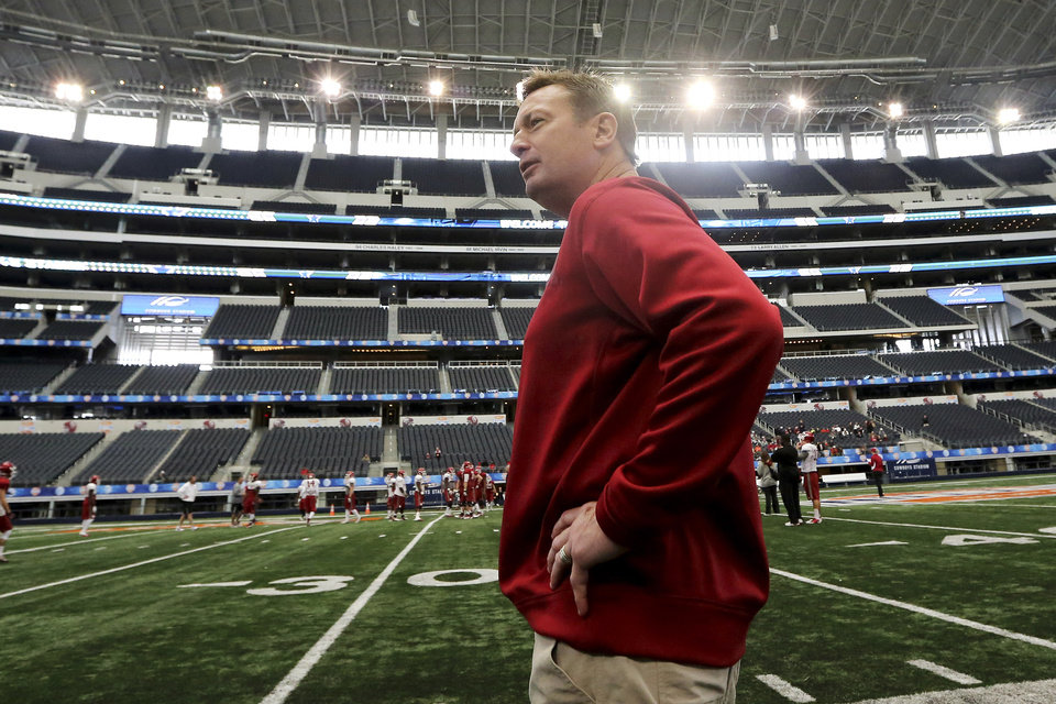 Photo - Oklahoma head coach Bob Stoops walks the sideline during practice after media day for the Cotton Bowl NCAA college football game at Cowboys Stadium, Sunday, Dec. 30, 2012, in Arlington, Texas. Oklahoma is scheduled to play Texas A&M on Jan. 4, 2013. (AP Photo/LM Otero) ORG XMIT: TXMO110