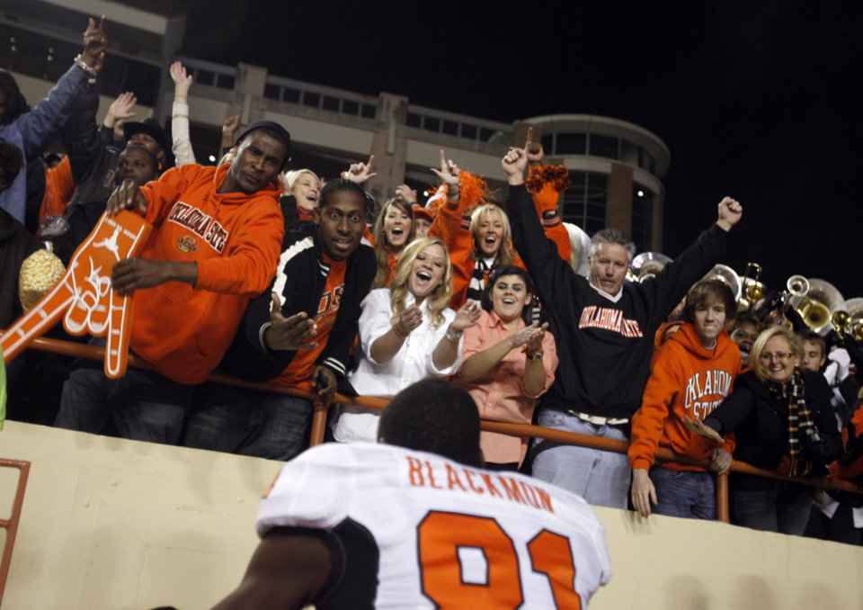 Photo - Oklahoma State's Justin Blackmon (81) celebrates the Cowboys' win over Texas with fans at Darrell K Royal-Texas Memorial Stadium in Austin, Texas, Saturday, November 13, 2010. Photo by Sarah Phipps, The Oklahoman