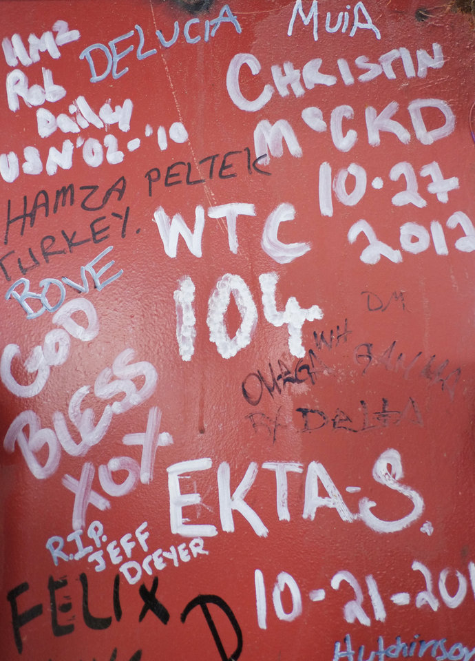 This Jan. 15, 2013 photo shows graffiti left by workers on a steel column on the 104th floor of One World Trade Center in New York. Construction workers finishing New York's tallest building at the World Trade Center are leaving their personal marks on the concrete and steel in the form of graffiti. (AP Photo/Mark Lennihan)