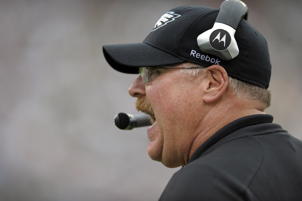 Photo - FILE - This Sept. 25, 2011 file photo shows Philadelphia Eagles coach Andy Reid calling out plays in the second half of an NFL football game against the New York Giants in Philadelphia. Reid and the Kansas City Chiefs should be quite familiar by now. The two sides spent much of Thursday, Jan. 3, 2013 in negotiations for Reid to become the Chiefs' coach, a person familiar with the situation told The Associated Press. The person spoke to the AP on condition of anonymity because he wasn't authorized to discuss the situation. (AP Photo/Michael Perez, File)