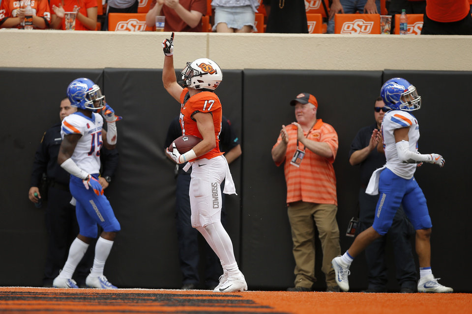 Photo - Oklahoma State's Dillon Stoner (17) celebrates after a touchdown during a college football game between the Oklahoma State University Cowboys (OSU) and the Boise State Broncos at Boone Pickens Stadium in Stillwater, Okla., Saturday, Sept. 15, 2018. Oklahoma State won 44-21. Photo by Bryan Terry, The Oklahoman
