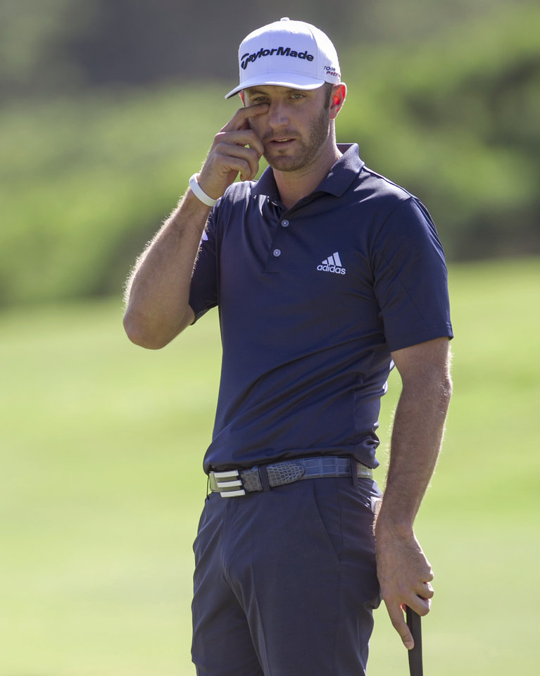 Dustin Johnson reacts to a missed putt on the first green during the final round of the Tournament of Champions golf tournament, Monday, Jan. 6, 2014, in Kapalua, Hawaii. (AP Photo/Marco Garcia)