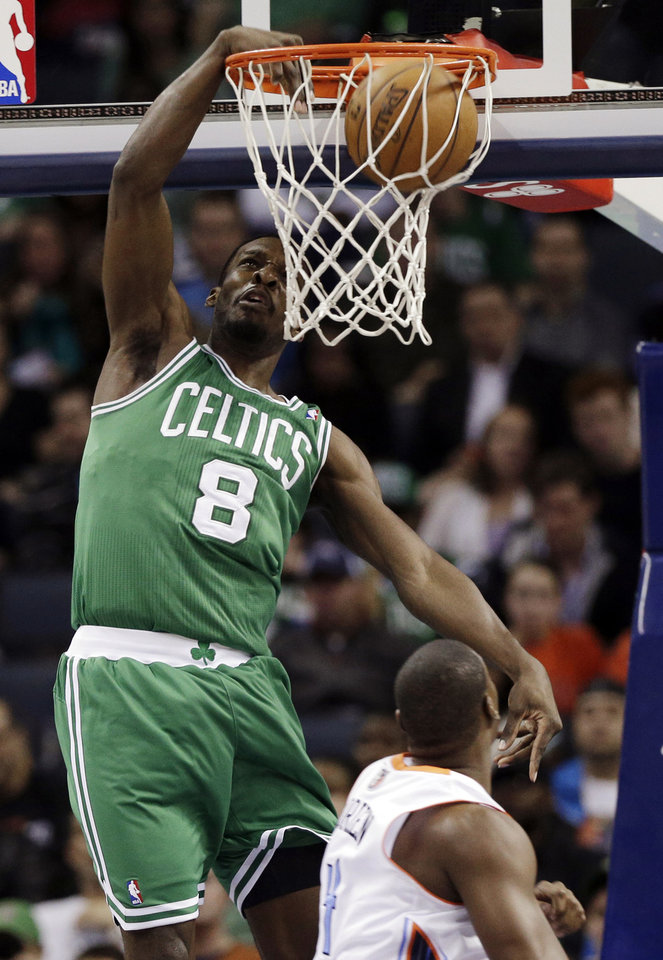 Boston Celtics' Jeff Green (8) dunks over Charlotte Bobcats' Jeff Adrien (4) during the first half of an NBA basketball game in Charlotte, N.C., Monday, Feb. 11, 2013. (AP Photo/Chuck Burton)