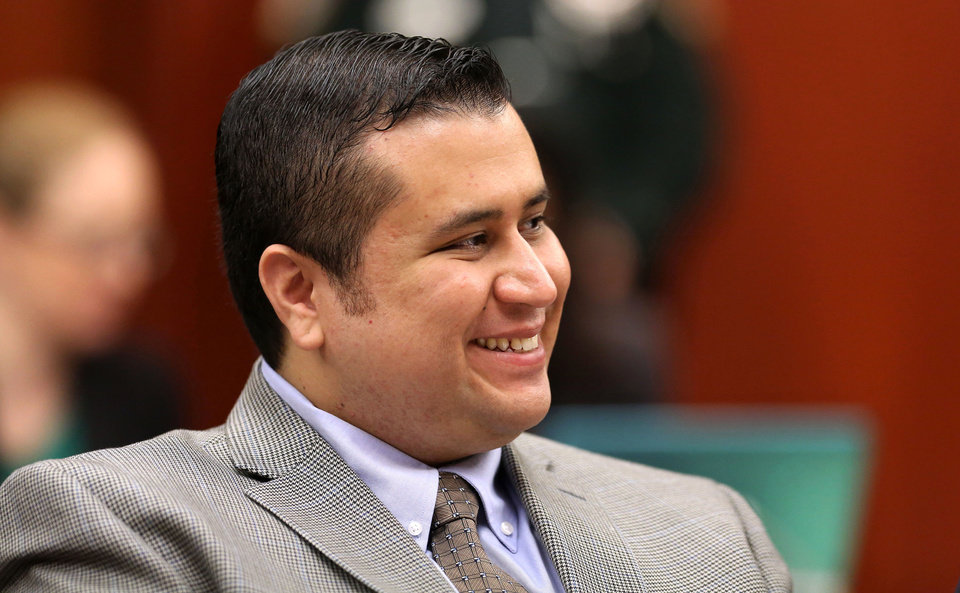 George Zimmerman smiles in response to a juror's answer during questioning in Seminole circuit court on the eighth day of his trial, in Sanford, Fla., Wednesday, June 19, 2013. Zimmerman has been charged with second-degree murder for the 2012 shooting death of Trayvon Martin.(AP Photo/Orlando Sentinel, Joe Burbank/Pool)