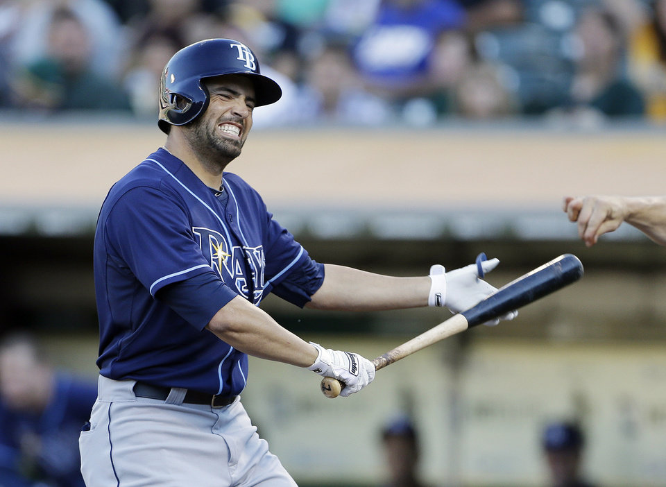 Tampa Bay Rays' David DeJesus reacts after striking out against Oakland Athletics starting pitcher Sonny Gray during the first inning of their baseball game Saturday, Aug. 31, 2013, in Oakland, Calif. (AP Photo/Eric Risberg)