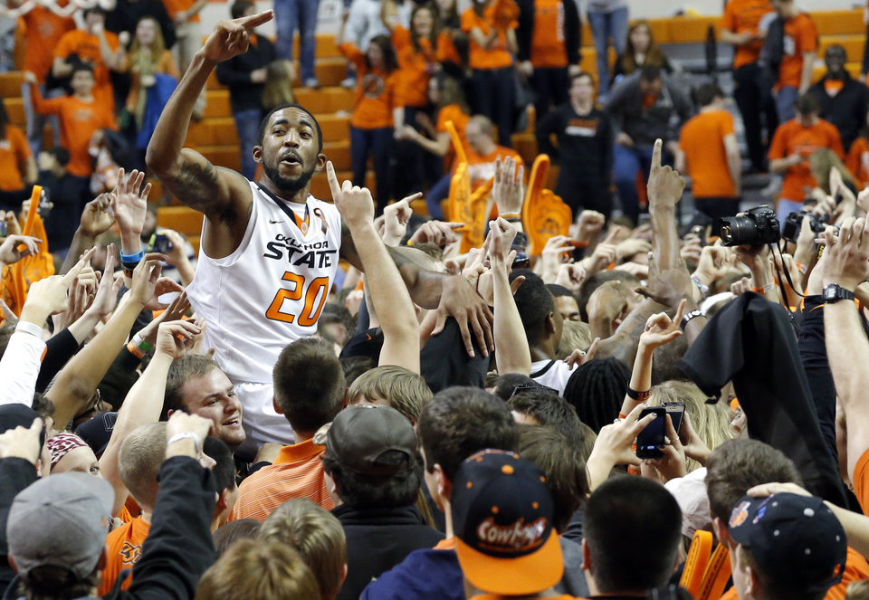 Oklahoma State\'s Michael Cobbins (20) celebrates with fans during the Bedlam men\'s college basketball game between the Oklahoma State University Cowboys and the University of Oklahoma Sooners at Gallagher-Iba Arena in Stillwater, Okla., Saturday, Feb. 16, 2013. Photo by Sarah Phipps, The Oklahoman
