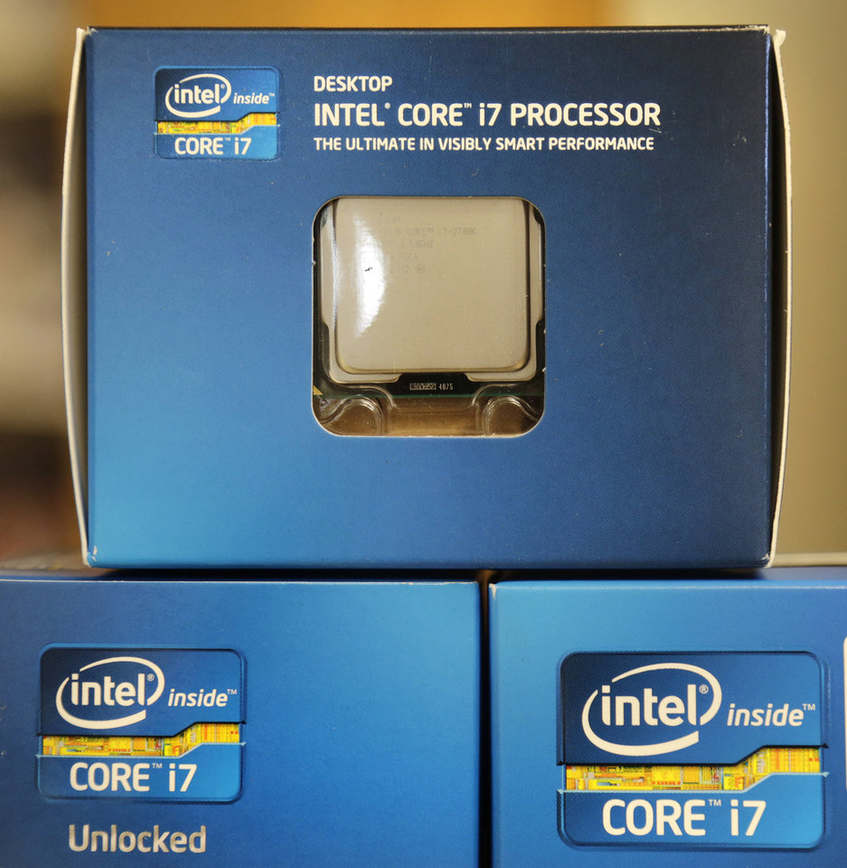 Photo -   In this Thursday, July 12, 2012, photo, Intel Core i7 processors are stacked at a store in Cambridge, Mass. Intel, the world's largest chipmaker, said Tuesday, July 17, 2012, the weak global economy is slowing its growth as its earnings fell 4.3 per cent in the latest quarter as operating expenses rose faster than revenue. (AP Photo/Charles Krupa)