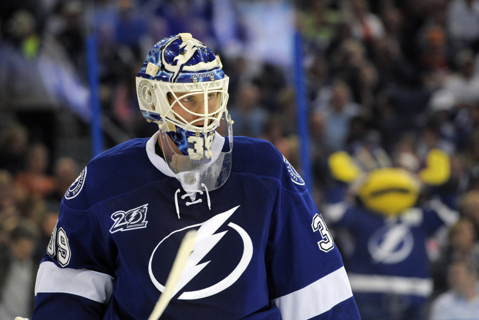 Photo - Tampa Bay Lightning goalie Anders Lindback takes a break from defending the goal during the third period of an NHL hockey game against the Toronto Maple Leafs on Tuesday, Feb. 19, 2013, in Tampa, Fla. (AP Photo/Brian Blanco)