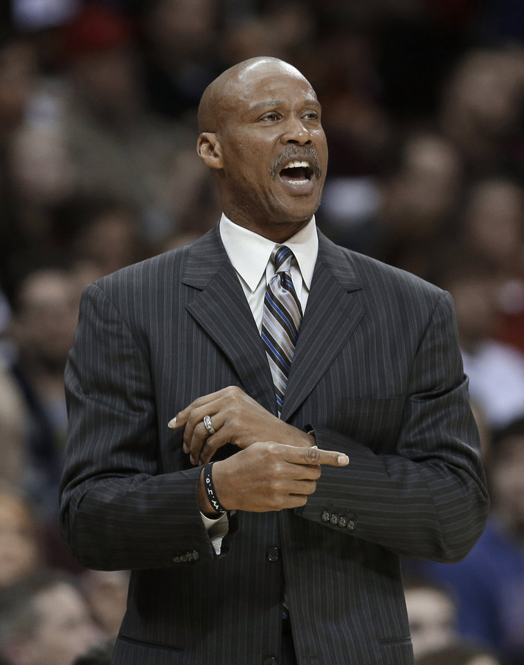 Photo - Cleveland Cavaliers coach Byron Scott makes a point during the second quarter of an NBA basketball game against the Toronto Raptors on Wednesday, Feb. 27, 2013, in Cleveland. The Cavaliers won 103-92. (AP Photo/Tony Dejak)