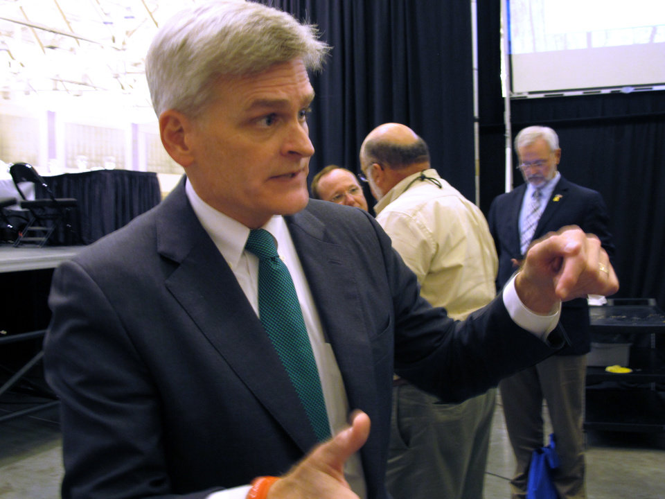 Photo - Republican U.S. Rep. Bill Cassidy speaks to the media about his campaign for Louisiana's U.S. Senate seat after talking at the Louisiana Municipal Association's annual convention on Saturday, Aug. 2, 2014, in Baton Rouge, La. Cassidy is running against three-term Democratic incumbent Sen. Mary Landrieu. (AP Photo/Melinda Deslatte)