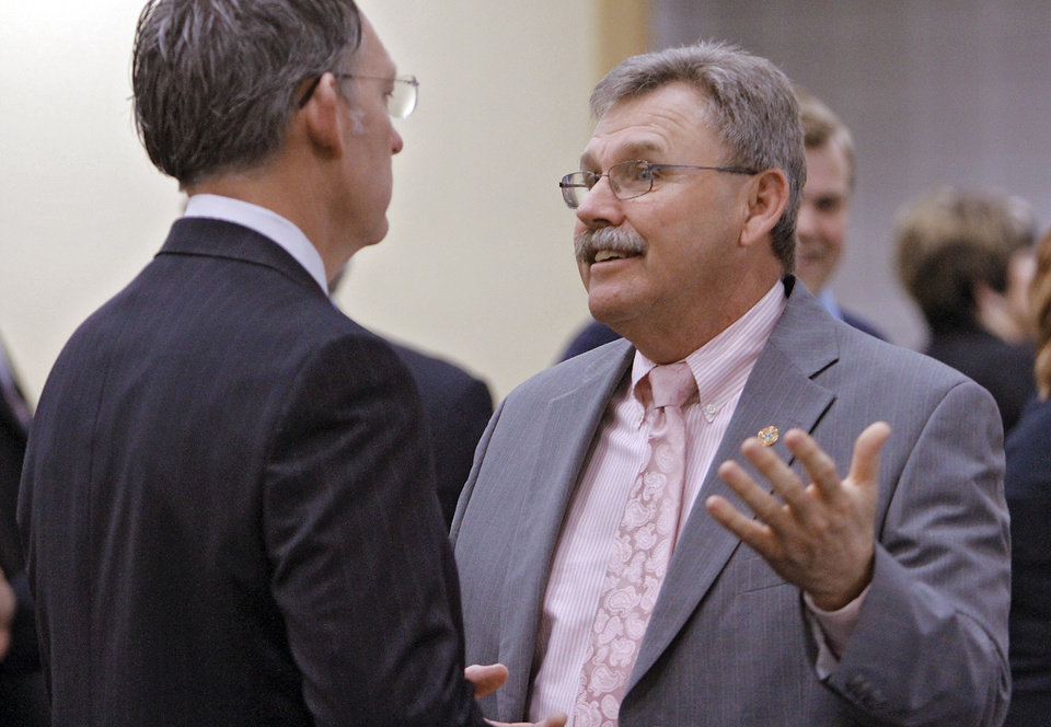 Midwest City Mayor Jack Fry speaks with Sen. Cliff Aldridge before the start of Fry\'s State of the City address at Rose State College on Friday, Feb. 24, 2012 in Midwest City, Okla. Photo by Chris Landsberger, The Oklahoman