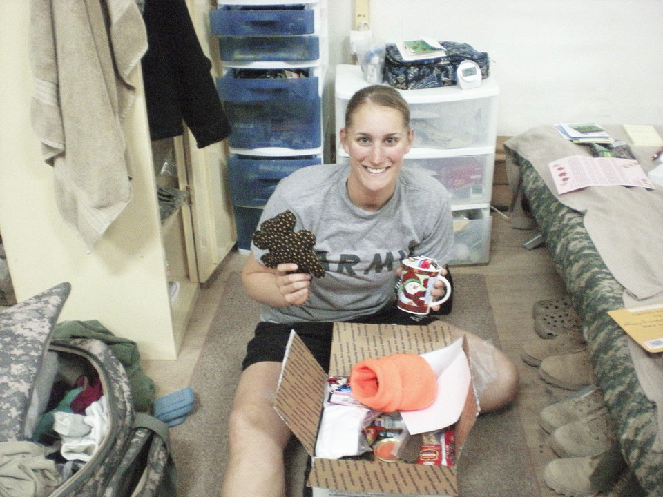 Military service member Katie Fichtner receives a care package from The Hugs Project.  Photo Provided
