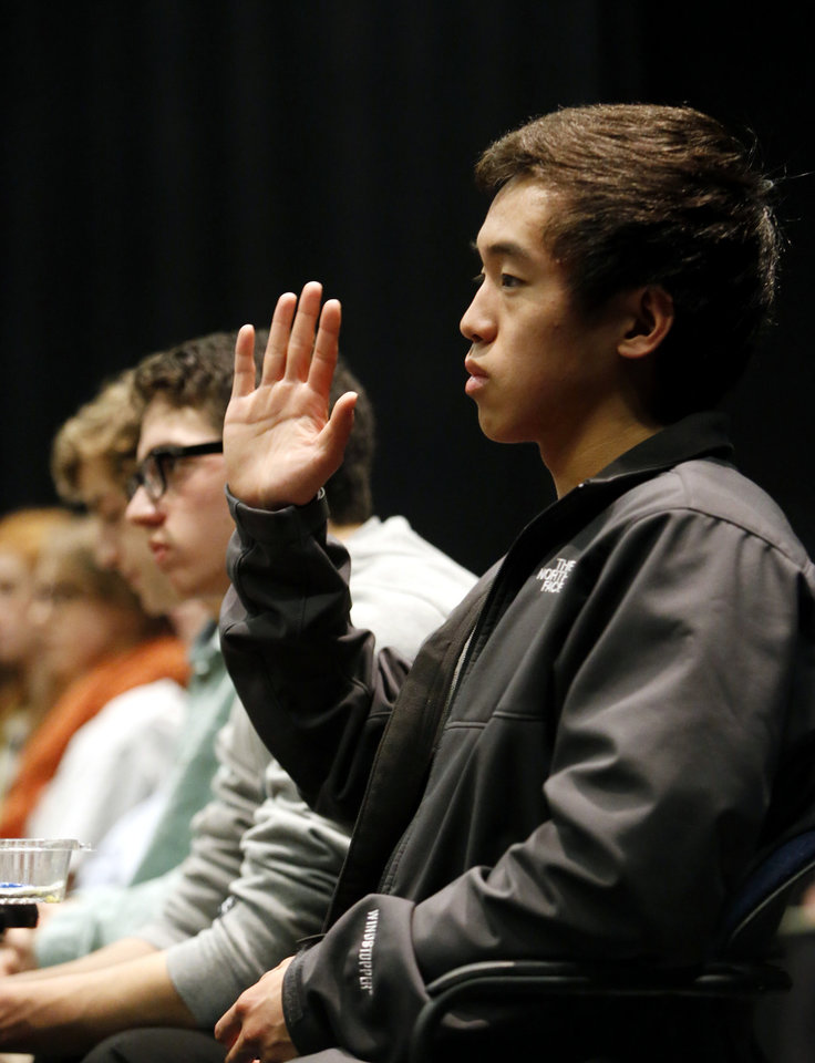 Norman North High School senior Alexander Zhu, asks a question of State School Superintendent Janet Barresi as she meets for lunch with about 20 Norman High and Norman North High School students as part of her Raise the Grade tour on Friday, Feb. 8, 2013 in Norman, Okla. Photo by Steve Sisney, The Oklahoman