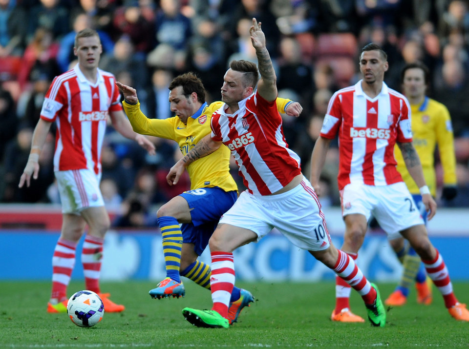 Photo - Stoke's Marko Arnautovic, right, battles for the ball with Arsenal's Santi Cazorla during the English Premier League soccer match between Stoke City and Arsenal at Britannia Stadium in Stoke On Trent, England, Saturday, March 1, 2014. (AP Photo/Rui Vieira)