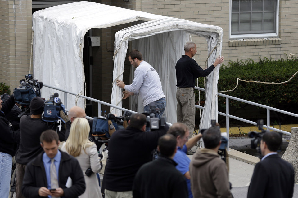 Photo -   A privacy tunnel is erected at the Centre County Courthouse Monday, Oct. 8, 2012, in Bellefonte, Pa. Former Penn State University assistant football coach Jerry Sandusky is scheduled to be sentenced Tuesday for sexually abusing 10 boys in a scandal that rocked the university and brought down coach Joe Paterno. (AP Photo/Matt Rourke)