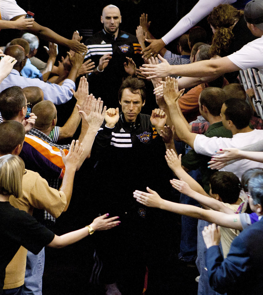Photo -   Phoenix Suns' Steve Nash, front center, takes the court for the Suns' NBA basketball game against the San Antonio Spurs on Wednesday, April 25, 2012, in Phoenix. This could be Nash's final game for the Suns. The two-time MVP and eight-time All-Star will become a free agent this summer and is seeking a three-year deal. (AP Photo/The Arizona Republic, Rob Schumacher) MARICOPA COUNTY OUT NO SALES