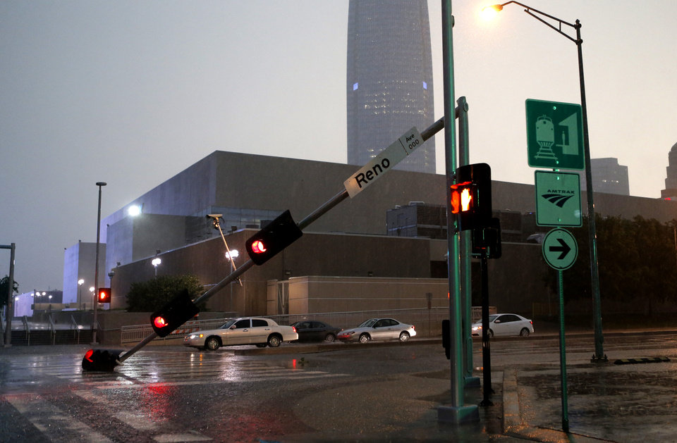 Photo - A traffic light rests on the street on E K Gaylord and Reno in Oklahoma City after a storm moves through the area in Oklahoma City, Friday, May 31, 2013. Photo by Bryan Terry, The Oklahoman