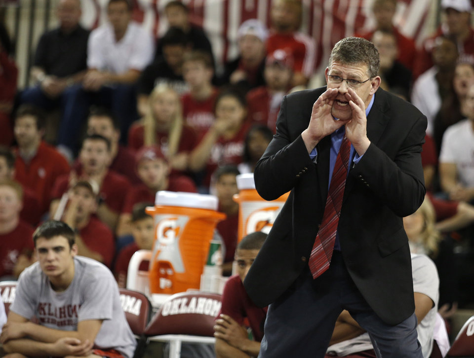 OU head coach Mark Cody yells from the bench during the wrestling match between Oklahoma University and Oklahoma State University at McCasland Field House in Norman, Okla.,Sunday, Dec. 9, 2012. Photo by Garett Fisbeck, For The Oklahoman
