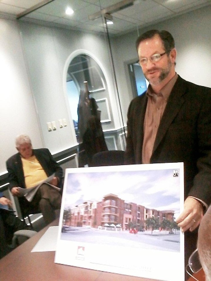 Gary Brooks presents renderings of his development, The Edge, at a recent meeting of the Oklahoma City Urban Renewal Authority. Photo by Steve Lackmeyer, The Oklahoman