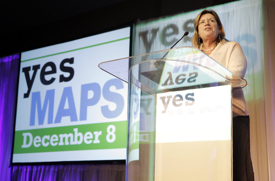 Photo - Jane Jenkins, president of Downtown Oklahoma City Inc., gives early returns to  supporters during the Yes for Maps 3 watch party at the Cox Convention Center in Oklahoma City, Tuesday, Dec. 8, 2009. Photo by Nate Billings, The Oklahoman