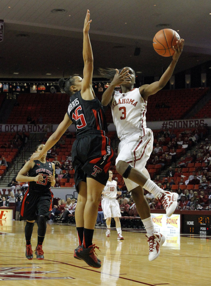 Oklahoma Sooner's Aaryn Ellenberg (3) drives to the basket guarded by Tech's Casey Morris (15) as the University of Oklahoma Sooners (OU) play the Texas Tech Lady Red Raiders in NCAA, women's college basketball at The Lloyd Noble Center on Saturday, Jan. 12, 2013 in Norman, Okla. Photo by Steve Sisney, The Oklahoman