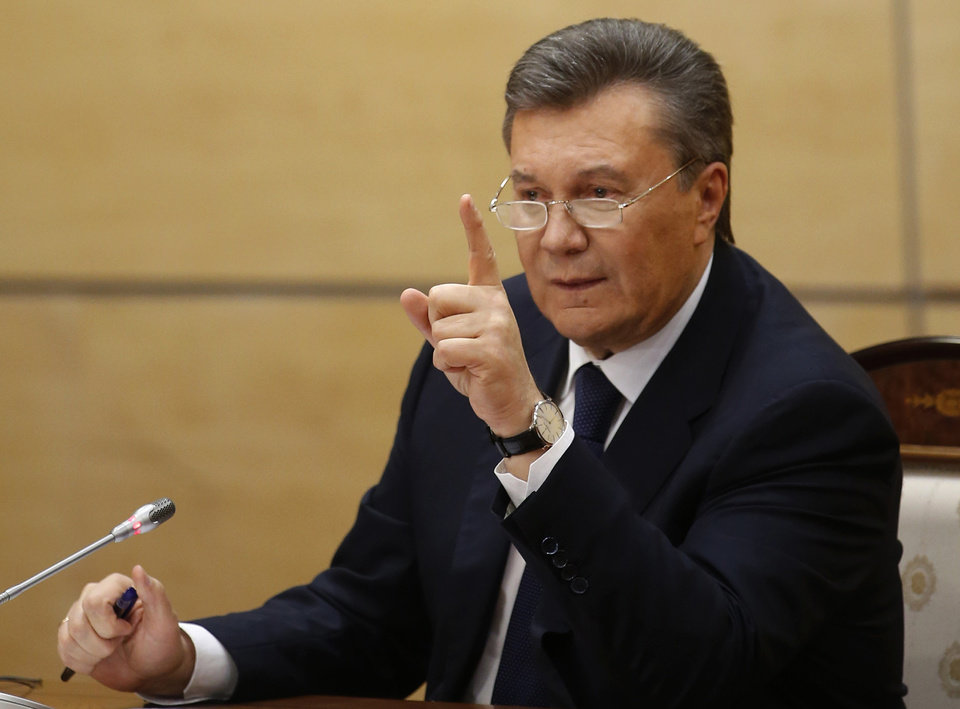 Photo - Ukraine's fugitive President Viktor Yanukovych gives a news conference in Rostov-on-Don, a city in southern Russia about 1,000 kilometers (600 miles) from Moscow, Friday, Feb. 28, 2014. Making his first public appearance since fleeing Ukraine, fugitive Ukrainian president Viktor Yanukovych pledged Friday to fight for his country's future but said he will not ask for military assistance. (AP Photo/Pavel Golovkin)