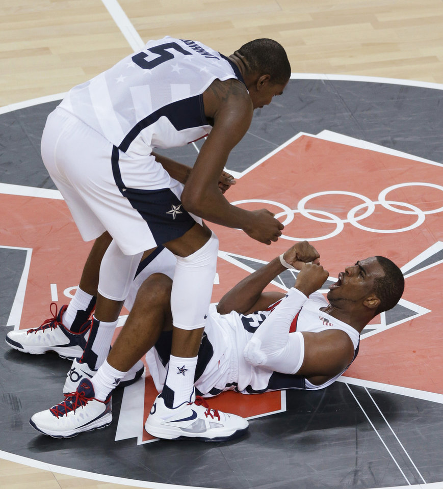 United States' Kevin Durant and Chris Paul celebrate during the men's gold medal basketball game against Spain at the 2012 Summer Olympics, Sunday, Aug. 12, 2012, in London. The United States defeated Spain 107-100 to win the gold medal. AP photo