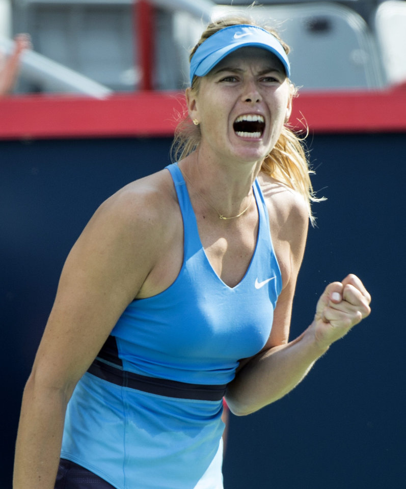 Photo - Maria Sharapova of Russia celebrates after beating Garbine Muguruza of Spain at the Rogers Cup tennis tournament Wednesday Aug. 6, 2014 in Montreal. (AP Photo/The Canadian Press, Paul Chiasson)