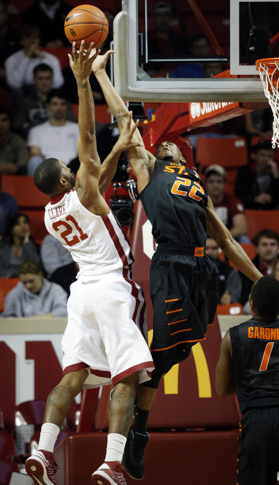 Photo - Sooner's Cameron Clark (21) shoots over Cowboy's Markel Brown (22) as the University of Oklahoma Sooners (OU) play the Oklahoma State Cowboys (OSU) in NCAA, men's college basketball at The Lloyd Noble Center on Saturday, Jan. 12, 2013  in Norman, Okla. Photo by Steve Sisney, The Oklahoman